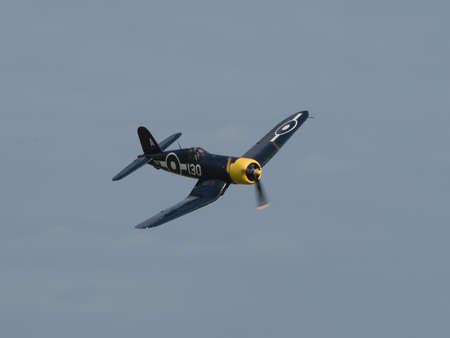 Duxford, UK - May 23rd 2015: A vintage US Chance Vought Corsair aircraft, flying at Duxford VE Day Airshow