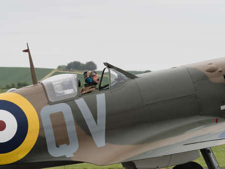 mk: Duxford, UK - May 23rd 2015: Pilot of a vintage British Spitfire Mk 1 fighter , displaying at Duxford VE Day Airshow Editorial