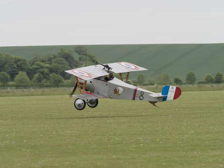 ve: Duxford, UK - May 23rd 2015: Vintage French Nieuport 17 Biplane of First World War, displaying at Duxford VE Day Airshow