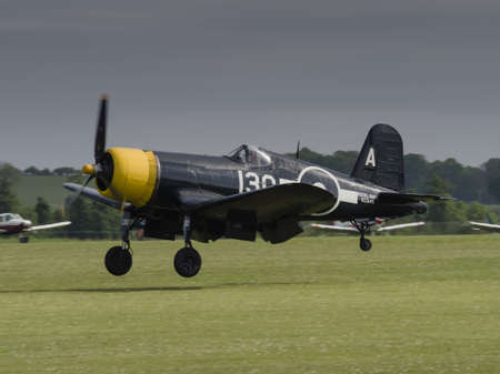 warbirds: Duxford, UK - May 23rd 2015: A vintage US Chance Vought Corsair aircraft, flying at Duxford VE Day Airshow