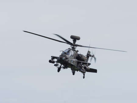 firepower: Duxford, UK - May 23rd 2015: An Apache Helicopter of the British Army, flying at Duxford VE Day Airshow