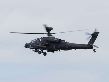 british army: Duxford, UK - May 23rd 2015: An Apache Helicopter of the British Army, flying at Duxford VE Day Airshow