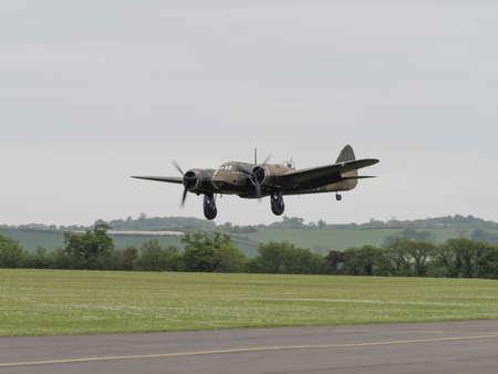 twin engine: Duxford, UK - May 23rd 2015: A vintage British Blenheim bomber , landing at Duxford VE Day Airshow