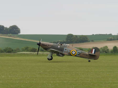 ve: Duxford, UK - May 23rd 2015: A vintage British Hawker Hurricane fighter , landing at Duxford VE Day Airshow