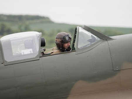Duxford, UK - May 23rd 2015: Pilot of a vintage British Spitfire Mk 1 fighter , displaying at Duxford VE Day Airshow Editorial