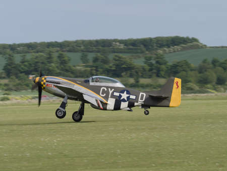 warbirds: Duxford, UK - May 23rd 2015: A vintage US P51 Mustang aircraft, flying at Duxford VE Day Airshow
