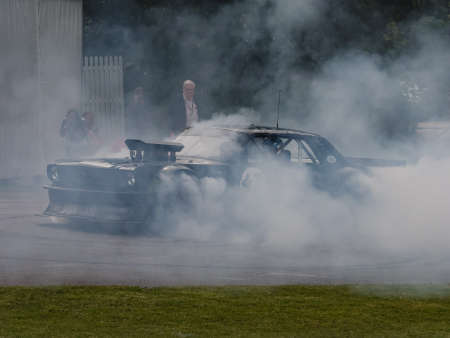 hillclimb: Goodwood, UK -26th June 2015: A heavily altered muscle car Ford Mustang 1965 Hoonigan. Performing donut at the Goodwood Festival of Speed. Editorial