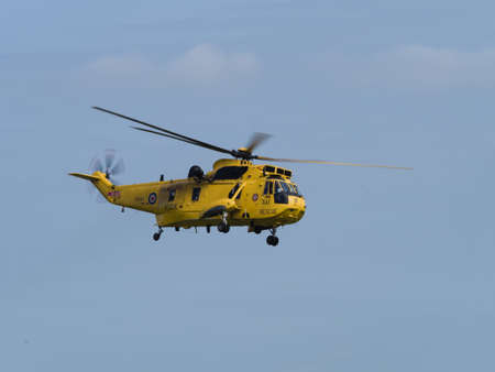 raf: Duxford, UK - May 23rd 2015: An RAF Air Sea Rescue Sea King helicopter, flying at Duxford VE Day Airshow Editorial