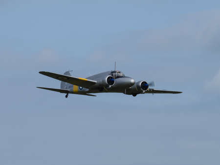 warbirds: Duxford, UK - May 23rd 2015: An RAF vintage Avro Anson aircraft, flying at Duxford VE Day Airshow Editorial