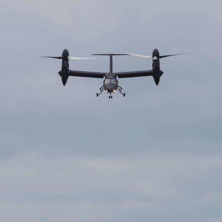 rotor: Yeovilton, UK - 11th July 2015: AgustaWestland AW609 tilt rotor aircraft flying at Yeovilton Air Day.