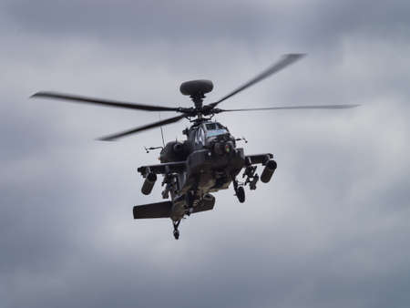 apache: Yeovilton, UK - 11th July 2015: Apache helicopter flying at Yeovilton Air Day. Editorial