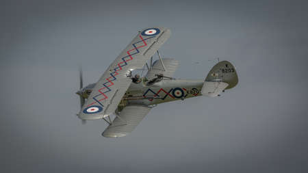 Biggleswade, UK - 7th May 2017: A vintage British Hawker Demon in flight Editorial