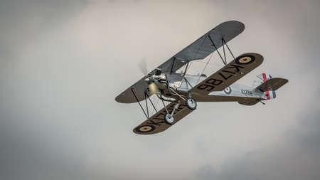 Biggleswade, UK - 7th May 2017: Vintage 1928 Hawker Tomtit biplane in flight