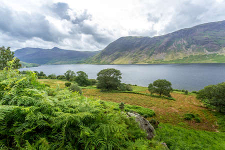 A landscape view of Crummock Water, one of the lakes in the Lake District, Cumbria, United Kingdom. Stock Photo