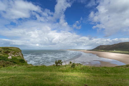 wales: A landscape view of Rhossili Bay, on the Gower Peninsula, Swansea, South Wales, UK