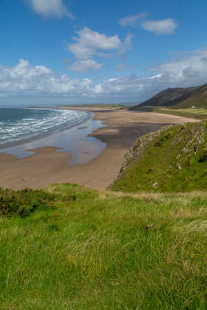 A landscape view of Rhossili Bay, on the Gower Peninsula, Swansea, South Wales, UK