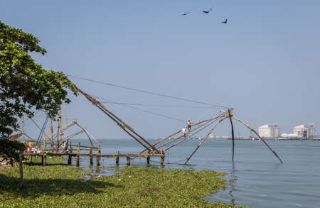 Fort Kochi, India - 16th November 2017: A view of the famous chinese stationary fishing nets on the shore side within the historic old town of Kochi, Kerala, India.