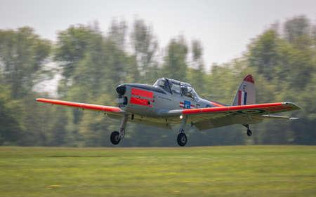 Biggleswade, UK - 6th May 2018: A beautiful vintage de Havilland  Chipmunk vintage aircraft landing at airfield