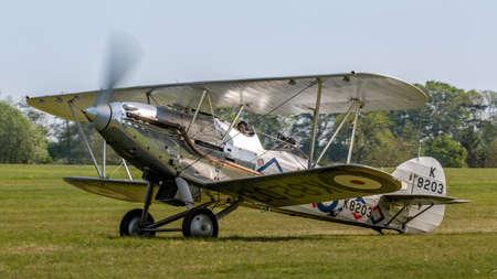 Biggleswade, UK - 6th May 2018:  A 1937 Hawker Demon vintage biplane landing at airfield