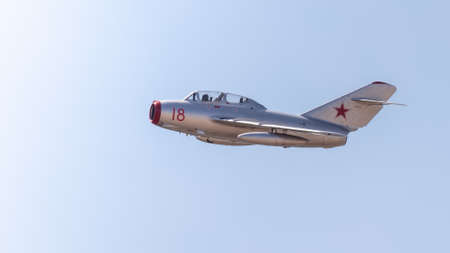 YEOVILTON, UK - 7th July 2018: A vintage Russian MIG 15 jet aircraft in flight over Yeovilton RNAS airfield in south western UK Editöryel