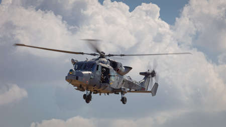 YEOVILTON, UK - 7th July 2018:  A Royal Navy Lynx HMA.8  helicopter in flight approaching Yeovilton  airfield in south western UK Editöryel