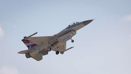 YEOVILTON, UK - 7th July 2018: An F16 fighter jet in flight over Yeovilton RNAS airfield in south western UK Editöryel