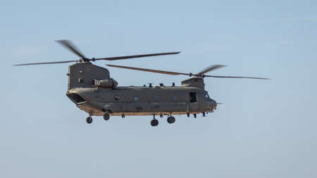 YEOVILTON, UK - 7th July 2018: An RAF Chinook helicopter in flight over Yeovilton RNAS airfield in south western UK