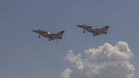 YEOVILTON, UK - 7th July 2018: French Dassault Rafale fighter jets in flight over Yeovilton RNAS airfield in south western UK