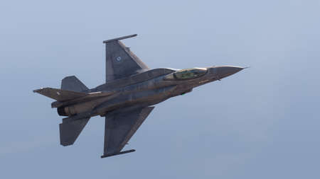 YEOVILTON, UK - 7th July 2018: A Greek Air Force F16 fighter jet in flight over Yeovilton RNAS airfield in south western UK