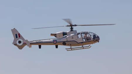 YEOVILTON, UK - 7th July 2018: A vintage Westland Gazelle HT.3 helicopter in flight over Yeovilton RNAS airfield in south western UK Editöryel