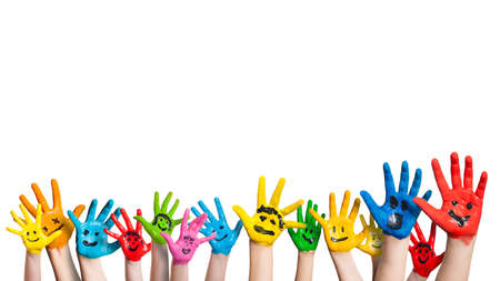 happy children: many colorful hands with smileys