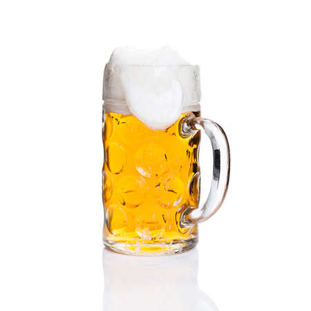 Full glass of beer on isolated background  photo
