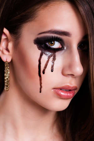 long depression: young sad girl with black tears