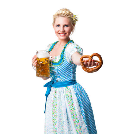 young woman in a dirndl with a beer and a pretzel