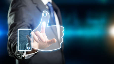 businessman pressing a thumb up symbol