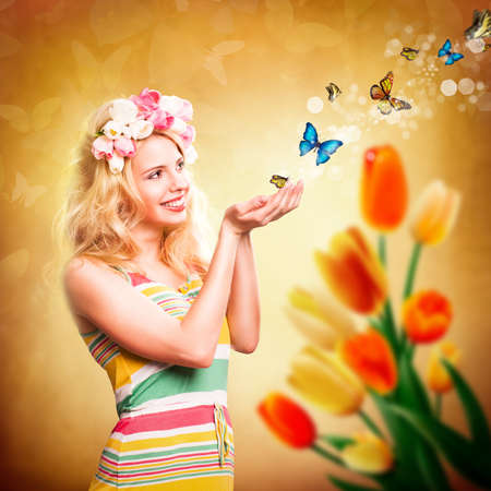 attractive young girl with tulip hair decoration and some butterflies photo