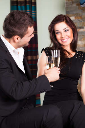friends clinking sparkling wine glasses at a party  photo