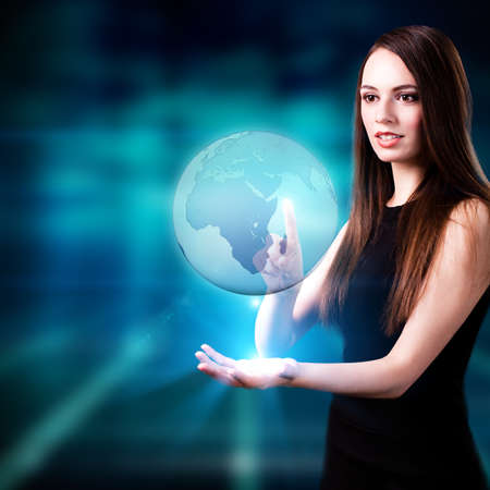 young woman with a world map hologram photo