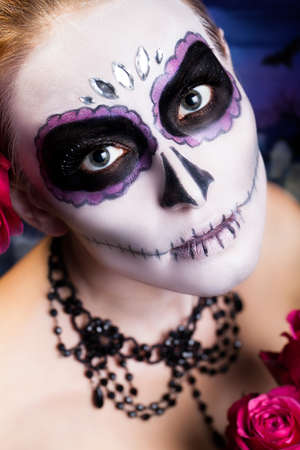 attractive woman with sugar skull styling