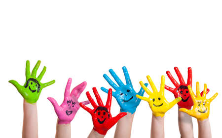 play of color: painted hands of children with smileys
