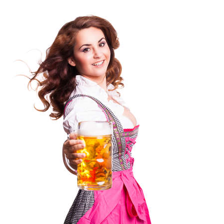 attractive woman in a pink dirndl holding a beer photo