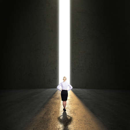 businesswoman standing in front of a portal  photo