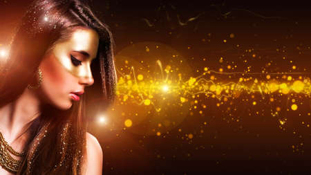 beautiful girl with a golden mask make up Stock Photo