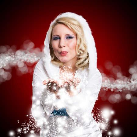 romper: attractive blonde girl blowing twinkling stardust