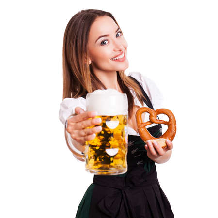 tracht: attractive woman in a traditional dirndl holding a beer