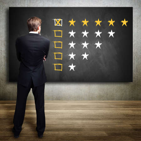 businessman watching a five star rating