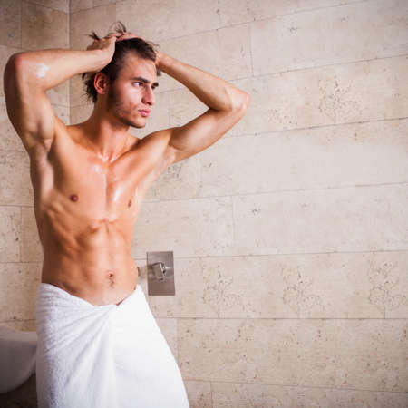 sexy shower: attractive man after having a shower  Stock Photo
