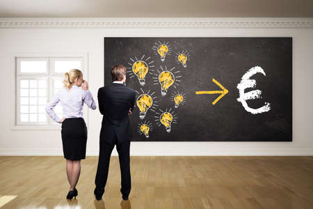 monetize: businesspeople thinking about how to monetize ideas into euro Stock Photo