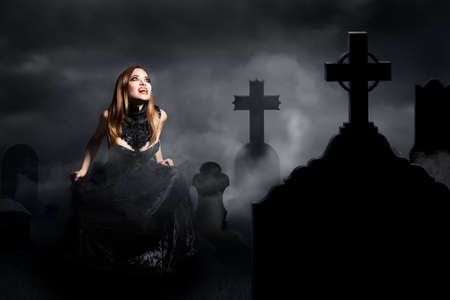 crying vampire on a graveyard