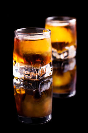 two rum shots with ice  photo